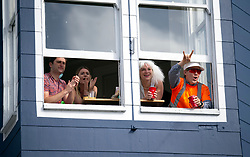 Spectators whose apartment fronts Hayes Street cheer on the participants in the 107th running of the Bay to Breakers, Sunday, May 20, 2018, in San Francisco. (Photo by D. Ross Cameron)