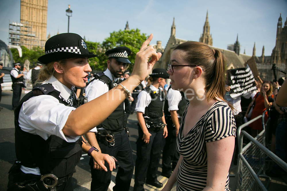 The Day of Rage protest organised by Movement for Justice  went from Shepherd's Bush to Downing Street and Parliament Square June 21st 2017, London, United Kingdom. Hundreds marched protesting against the Governments respond to the Grenfell Tower disaster. The mood was angry but peacefull and ended on Parliament Square green after police made people get of the streets and let traffic re-assume.