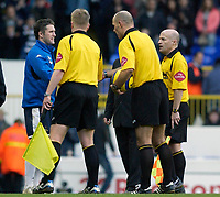 Photo: Daniel Hambury.<br />Tottenham Hotspur v Newcastle United. The Barclays Premiership. 31/12/2005.<br />Tottenham's Robbie Keane (L), who had three goals ruled out for off side, shakes hands with the officials at the end of the game.