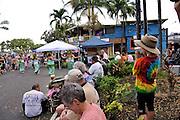 8 year old child wearing Akubra hat, videoing dancers in monthly street market, the Village Stroll, Kailua-Kona, Big Island, Hawaii