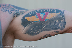 Victory tattoo in the Weir's during Laconia Motorcycle Week. NH, USA. June 21, 2014.  Photography ©2014 Michael Lichter.