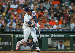 April 30, 2018 - Houston, TX, U.S. - HOUSTON, TX - APRIL 30:  Houston Astros first baseman Yuli Gurriel (10) lines out to right in the bottom of the first inning during the baseball game between the New York Yankees and Houston Astros on April 30, 2018 at Minute Maid Park in Houston, Texas.  (Photo by Leslie Plaza Johnson/Icon Sportswire) (Credit Image: © Leslie Plaza Johnson/Icon SMI via ZUMA Press)