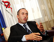 AAK party leader Ramush Haradinaj during an interview with a local journalist at his party's HQ in capital Pristina, Sept 4, 2009. (Photo/Vudi Xhymshiti)