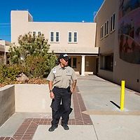 102313       Brian Leddy<br /> Wyatt King keeps an eye out at City Hall Wednesday morning. The city recently hired Red Rock Security and Patrol after several incidents of theft and public intoxication.