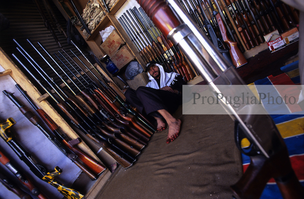 Kabul, 14 August 2005...A local shopkeeper sells Pakistani shotguns and ammunition...The Beretta Style is on offer.