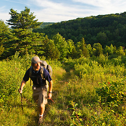A man hiking the Appalachian Trail on Tyringham Cobble, Tyringham, Massachussets.