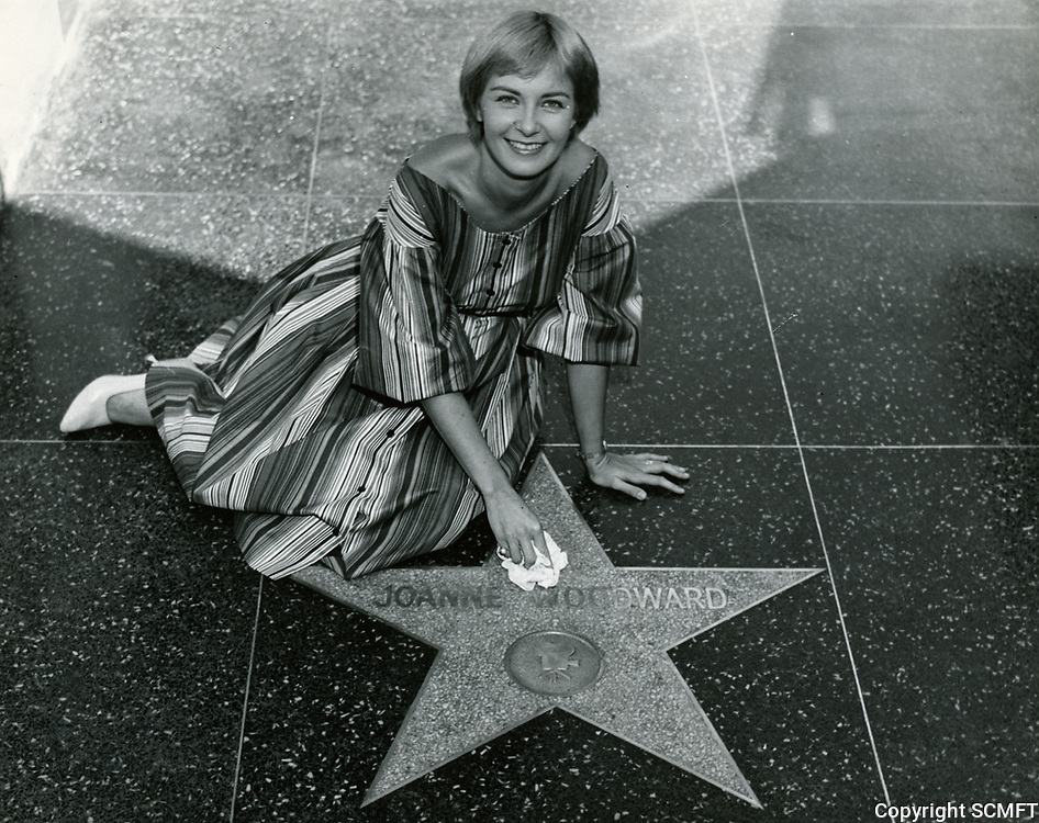 September 1958 Joanne Woodward was the first celebrity to pose by their Walk of Fame star. She was one of eight celebrities who were the first to have their names placed on the Hollywood Walk of Fame