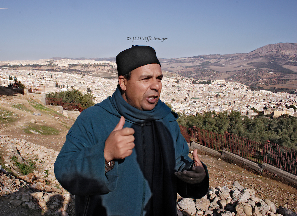 View of the Fes medina from the hill opposite.  Tour guide Aziz gestures, explaining the history of Fes.