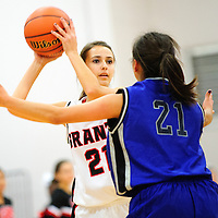 121512  Adron Gardner<br /> <br /> Grants Pirate Ashley Masters (21) is guarded by Navajo Pine Warrior Kaitlin Chee (21)  in the Eddie Pena Holiday Classic championship at Grants High School Saturday.