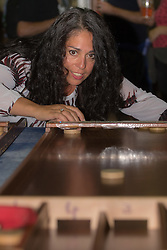 Olympia, London, August 9th 2015. Hundreds of real ale lovers attend the Campaign for Real Ale  Great British Beer Festival at London's Olympia Exhibition Centre, where dozens of independent breweries demonstrate the diversity of British brewed beers. PICTURED: A woman plays a pub game.
