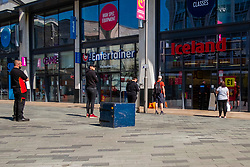 Week five of the Lockdown in Sheffield and Covid-19 has changed  the face of shopping while some shoppers choose to wear facemasks most do not , customers are required to wait outside shops and security guards administer new rules Sheffield <br /> <br /> 24 April 2020<br /> <br /> www.pauldaviddrabble.co.uk<br /> All Images Copyright Paul David Drabble - <br /> All rights Reserved - <br /> Moral Rights Asserted -