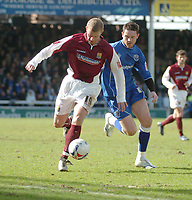 Photo: Ian Hebden.<br />Peterborough United v Northampton Town. Coca Cola League 2. 01/04/2006.<br />Northamptons Martin Smith (L) tussles with Peterboroughs Mark Arber (R).