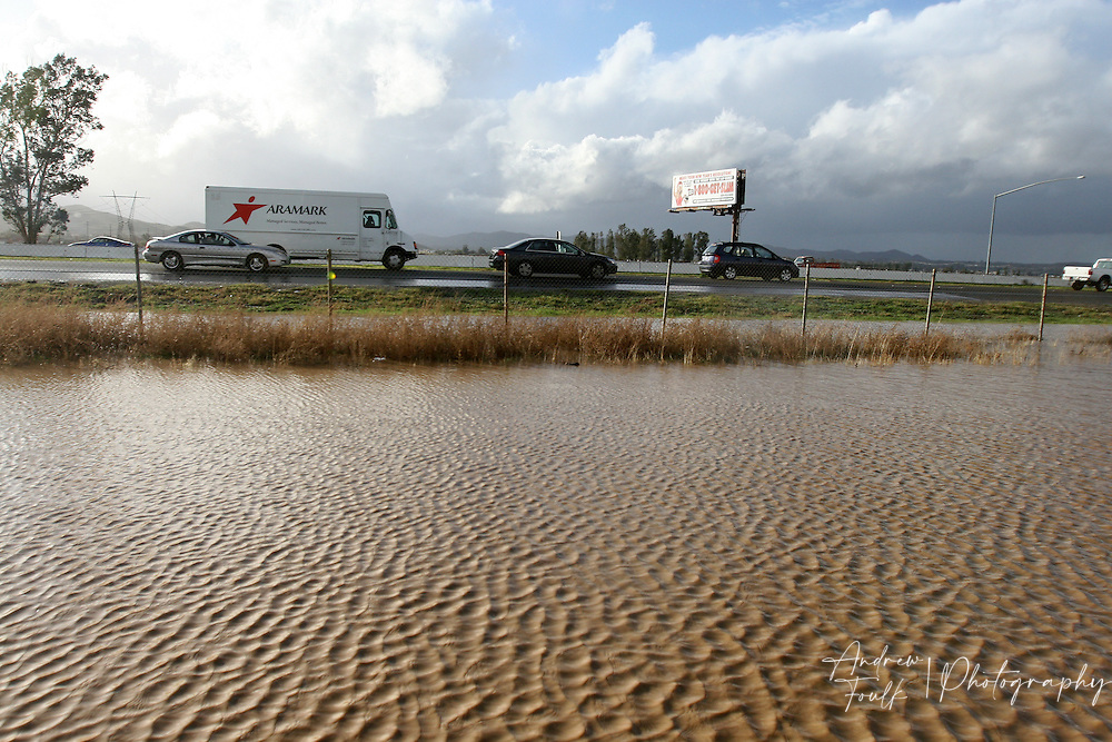 Traffic movers North on the 215 freeway near Ethanac off ramp in Sun City after a winter storm dumped huge amouts of rain Thursday afternoon.