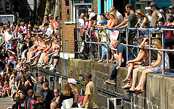 © Licensed to London News Pictures. 22/07/2012. Bristol, UK. People soak up the sun at the Bristol Harbour Festival in Bristol docks.  22 July 2012..Photo credit : Simon Chapman/LNP