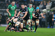 Justin Tipuric of the Ospreys ® passes the ball out. Guinness Pro12 rugby match, Ospreys v Connacht rugby at the Liberty Stadium in Swansea, South Wales on Saturday 7th January 2017.<br /> pic by Andrew Orchard, Andrew Orchard sports photography.