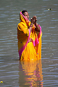 India, Uttarakhand, Rishikesh, Pilgrims bathe in the Ganges River