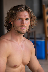 hot man without a shirt at home