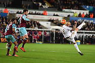 Jonjo Shelvey of Swansea city ® tries an acrobatic effort at goal. Barclays Premier league match, Swansea city v West Ham Utd at the Liberty Stadium in Swansea, South Wales  on Sunday 20th December 2015.<br /> pic by  Andrew Orchard, Andrew Orchard sports photography.
