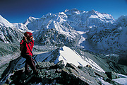 Kangchenjunga, North Face (8598m), sherpa on summit of Pangperma Peak (6225m), East Nepal