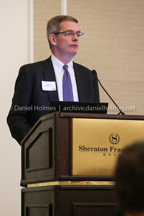 (5/22/19, FRAMINGHAM, MA) Senior Vice-President of Community Banking at Middlesex Savings Bank, David Bennett, speaks during the The MetroWest Economic Research Center's 27th annual conference at the Sheraton in Framingham on Wednesday. [Daily News and Wicked Local Photo/Dan Holmes]