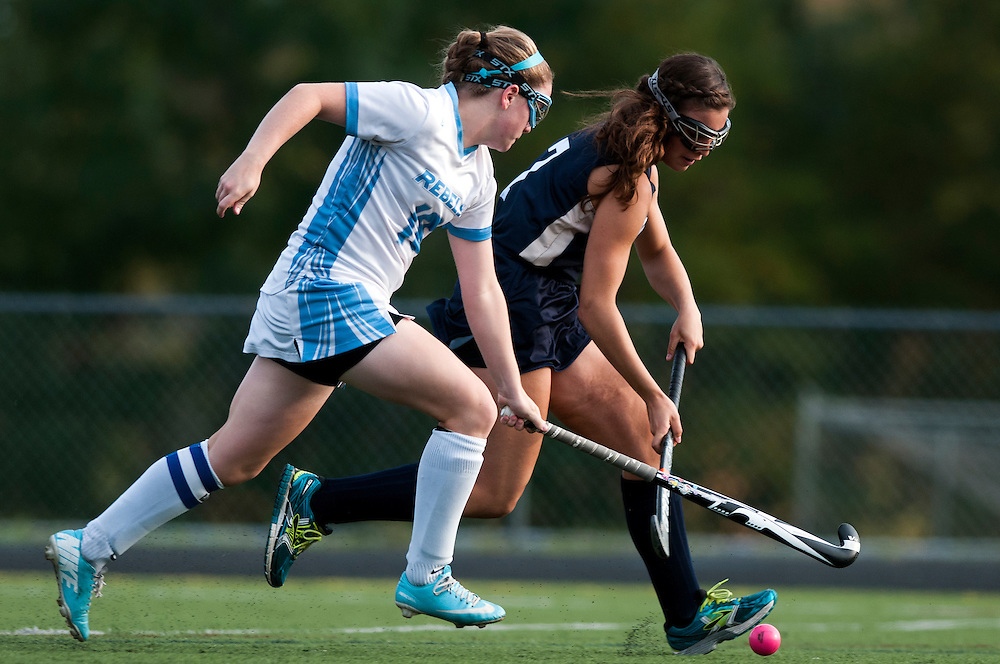 South Burlington's Casey Johnson (18) tries to steal the ball away from Essex's Erin Murphy (7) during the girls varsity field hockey game between the Essex Hornets and the South Burlington Rebels at South Burlington High School on Tuesday afternoon September 30, 2014 in South Burlington, Vermont. (BRIAN JENKINS, for the Free Press)
