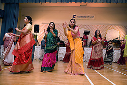 Women in traditional costume dancing during the celebration of Navratri; the Hindu festival of Nine Nights,