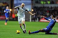 Swansea city's Jonjo Shelvey goes past Everton's Sylvain Distin. Barclays Premier league, Swansea city v Everton at the Liberty Stadium in Swansea,  South Wales on Sunday 22nd Dec 2013. pic by Andrew Orchard, Andrew Orchard sports photography.