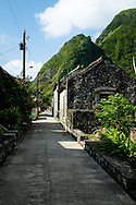 Philippines, Batanes. Main street of Chavayan, a tiny, picturesque town situated on the Sabtang Island.