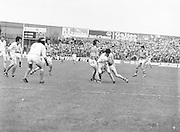 Armagh is in possession of the ball but two Roscommon players tackle him during the All Ireland Senior Gaelic Football Semi Final Replay Roscommon v Armagh in Croke Park on the 28th August 1977. Armagh 0-15 Roscommon 0-14.