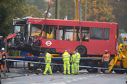 ©Licensed to London News Pictures 01/11/2019.<br /> Orpington,UK. One of the buses being removed. One person is dead and 15 others have been injured in a crash between two buses and a car last night in Orpington, South East London. A man has been arrested for dangerous driving. Police are still on scene and a cordon is in place. Photo credit: Grant Falvey/LNP