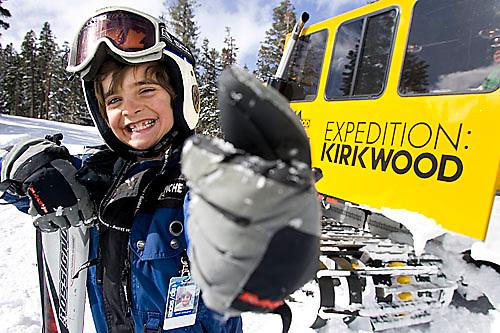 Kids riding snow cat and skiing at Kirkwood, CA.<br />