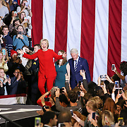 Democratic Presidential nominee, Hillary Clinton, arrives on stage with her husband, former President, Bill Clinton and their daughter, Chelsea Clinton, at a midnight rally at NC State in Raleigh, NC.