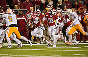 Nov 12, 2011; Fayetteville, AR, USA;  Arkansas Razorback running back Dennis Johnson (33) makes a punt return as wide receiver Javontee Herndon (19) and cornerback Jerry Mitchell (38) block and Tennessee Volunteers safety Nick Guess (59) and punter Matt Darr (5)  look on during the first half at Donald W. Reynolds Razorback Stadium. Arkansas defeated Tennessee 49-7. Mandatory Credit: Beth Hall-US PRESSWIRE
