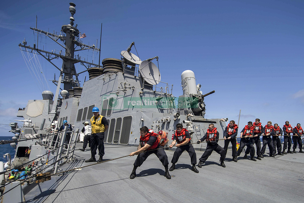 Apr 13, 2017 - USS Shoup (DDG 86), Pacific Ocean - Heaving a Line. Sailors aboard the USS Shoup heave line during a replenishment at sea in the Pacific Ocean, April 13, 2017. The ship was underway conducting a composite training unit exercise to prepare for a deployment.  (Credit Image: ? Seaman Maria Alvarez/DoD via ZUMA Wire/ZUMAPRESS.com)
