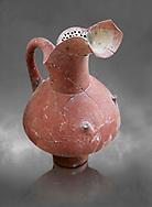 Hittite spouted pitcher with strainer, Hittite capital Hattusa, Hittite  Middle  Kingdom 1650-1450 BC, Bogazkale archaeological Museum, Turkey. Grey  background