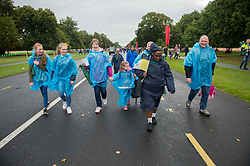 © Licensed to London News Pictures. 26/08/2018. Dublin, Ireland. Crowds gather in wet weather during the visit of Pope Francis to Phoenix Park Dublin. Pope Francis said mass to an estimated hundred thousand people. Pope Francis is the 266th Catholic Pope and current sovereign of the Vatican. Photo credit: Barry Cronin/LNP