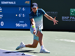 March 16, 2019 - Indian Wells, CA, U.S. - INDIAN WELLS, CA - MARCH 15: Dominic Thiem (AUT) hits the ball in the second set of a semifinals match played during the BNP Paribas Open at the Indian Wells Tennis Garden in Indian Wells, CA.  (Photo by John Cordes/Icon Sportswire) (Credit Image: © John Cordes/Icon SMI via ZUMA Press)