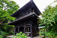 """Eishoji Temple Gate - Eisho-ji is the only convent remaining in Kamakura and was built in the early Edo Period in 1636.  Its full name is Tokozan Eishoji but it is almost always called just Eishoji.  It's nickname is the """"flower temple"""" though it is most noteworthy for its bamboo grove and cave niches with buddha statues inside.   Eishoji was founded as a nunnery by Okatsu, the temple's named was derived from her nun name Eiisho-in."""