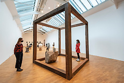 """© Licensed to London News Pictures. 27/09/2021. LONDON, UK. Staff members view """"Drinking Cube"""", 2019, by Theaster Gates. Preview of """"A Clay Sermon"""", a new exhibition by Chicago artist Theaster Gates.  The display, an investigation into the significance of clay in global trade, colonial expansion, slavery and abolitionism in the UK, is on show at Whitechapel Gallery 29 September to 9 January 2022.   Photo credit: Stephen Chung/LNP"""