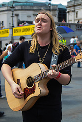 London, July 18th 2015.  A singer performs in Trafalgar Square during the Busk in London Festival aimed at showcasing the outstanding talents of many of the capital's finest street performers, including, musicians, magicians, living statues and bands.