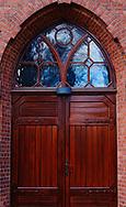 Wooden arched gothic doorway