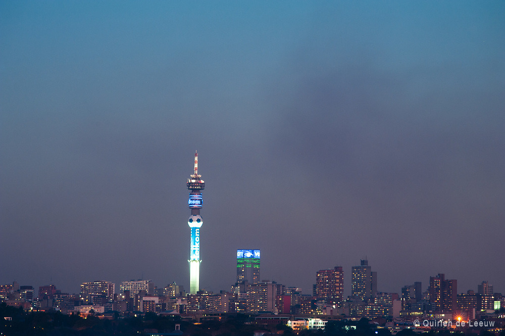 Johannesburg Central Business District, skyscrapers and Hillbrow tower at night, Gauteng province, South Africa.