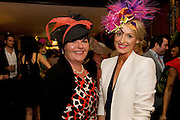 Miliner Suzi O Maohny with Winner Orla Sheridan from Foxford Co. Mayo wearing one of Suzie's designs(Prize) at the Hotel Meyrick's Best Dressed competition in the hotel in Eyre Sq. Galway during Galway's Race week . Photo:Andrew Downes