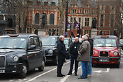 Licensed taxi drivers block the traffic in Parliament Square between 1pm-4pm in protest against traffic policies, 11th of February 2019, Central London, United Kingdom. Taxi drivers stand in Parliament Square, next to their parked up cabs. The disgruntled taxi drivers feel squeezed by local government transport policies.They say they will continue their protest and blockade the square every other day the same time until they feel the Mayor of London listens to them.