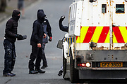 Loyalist protesters are seen hurling bricks at PSNI during further unrest on the Lanark Way in West Belfast on Monday, April 19, 2021. The cause of the unrest has been attributed to frustration over a decision not to prosecute members of Sinn Fein over alleged coronavirus regulation breaches at the funeral of republican Bobby Storey. Loyalists are also protesting over the Brexit Northern Ireland Protocol across various locations in the British province. (Photo/ Vudi Xhymshiti)