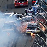 Erik Jones (20) and Brian Scott (2) collide, starting a multi-car accident with JJ Yeley (28), Elliott Sadler (1), Jeffery Earnhardt (55) and Darrell Wallace Jr. (6), during a NASCAR Xfinity series auto race at Daytona International Speedway, Saturday, Feb. 21, 2015, in Daytona Beach, Fla.   (AP Photo/Alex Menendez)