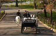 """Horse drawn caisson with the US Army Honor Guard sentries of the 3rd. US Infantry, known as """"The Old Guard"""" proceeding after a military honors funeral in Arlington National Cemetery in Arlington, VA on Monday, April 18, 2005."""