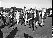Charles Haughey Visits The Community Games. (T5)..1989..03.10.1989..10.03.1989..3rd September 1989..An Taoiseach, Charles Haughey TD,accompanied by Mr Frank Fahey, TD, Minister of State with responsibility for Youth and Sport attended the Twentieth National Finals of the Community Games at Mosney,  Co.Meath yesterday...Image shows  An Taoiseach,Charles Haughey TD, with the games organising committee strolling across the playing fields at Mosney..