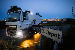 © Licensed to London News Pictures. 05/10/2021. A fuel tanker leaves Buncefield oil depot in Hemel Hempstead, Hertfordshire at first light. Military personnel have started helping with driver shortages  following more than a week of long queues and closures at petrol stations. Photo credit: Ben Cawthra/LNP