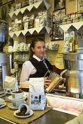 A female barista at Bar Italia on Frith Street, Soho on 19th October 2015 In London, United Kingdom.